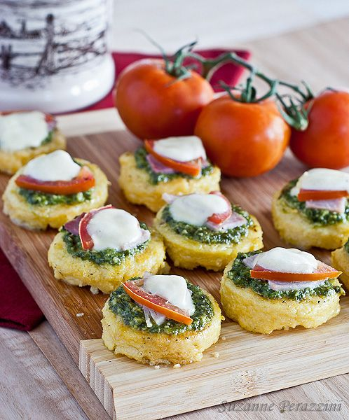 Pesto, Mozzarella Polenta Appetizers..These would be really easy using the logs of polenta already made.