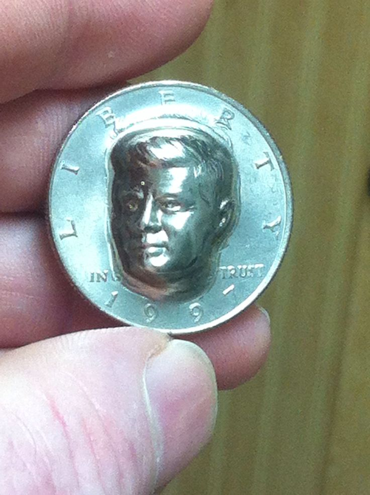 Obverse side is a custom raised Kennedy half dollar