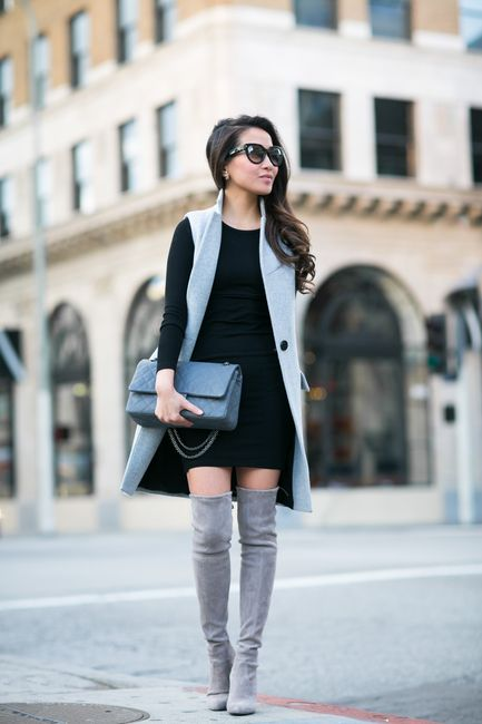 Winter outfit: grey long wool vest, black knit dress with long sleeves, grey overknee boots, grey Chanel bag