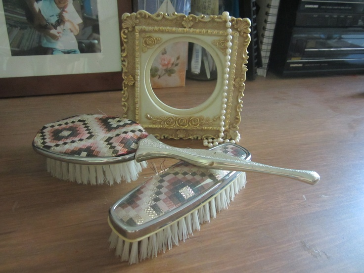 Photo frame, pearls, hair brush and comb for dresser.