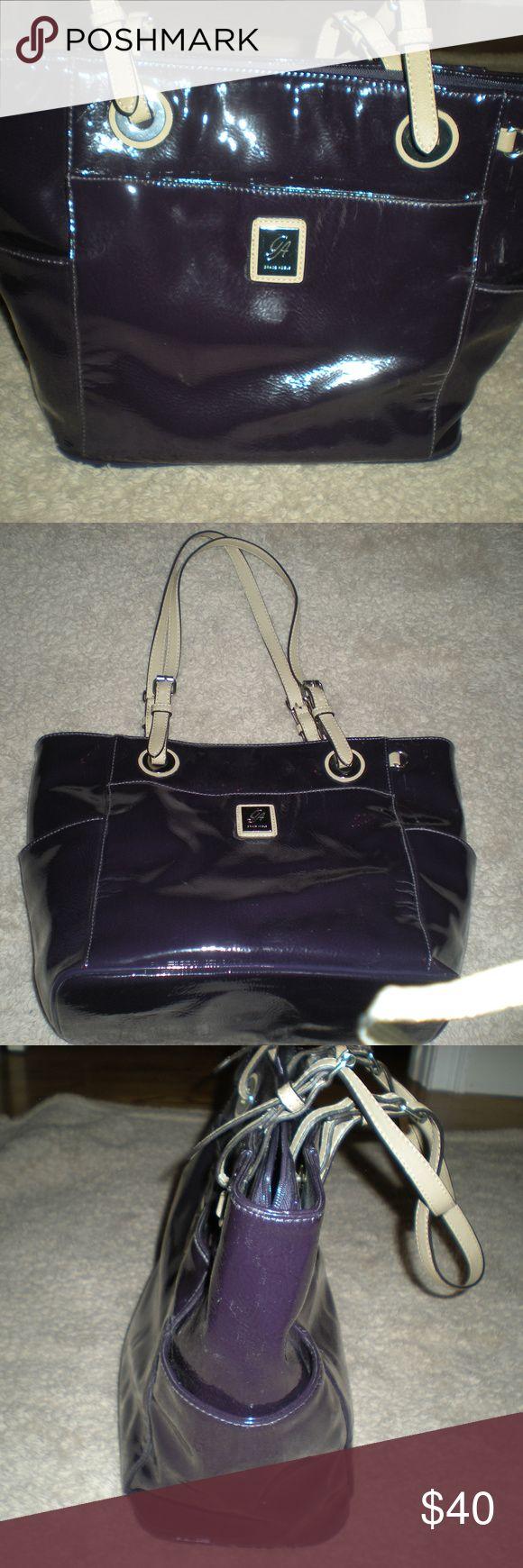 """Grace Adele Purple Shoulder Bag Grace Adele Purple Shoulder Bag.  Gently used.  Three exterior slip pockets.  Two interior slips pockets.  Two interior snap closure pockets.  Center divider with zip closure.  Adjustable shoulder straps.  Approximately 12""""W x 10""""H x 6""""D. Grace Adele Bags Shoulder Bags"""