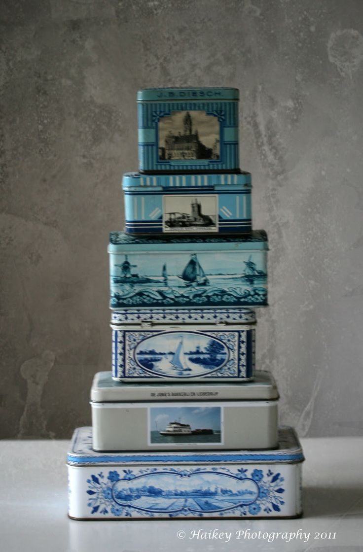 A stack of tins. Tins are great utilized to hold tea, buttons, paperclips, etc. I love the blue and white quaint Dutch scenes.