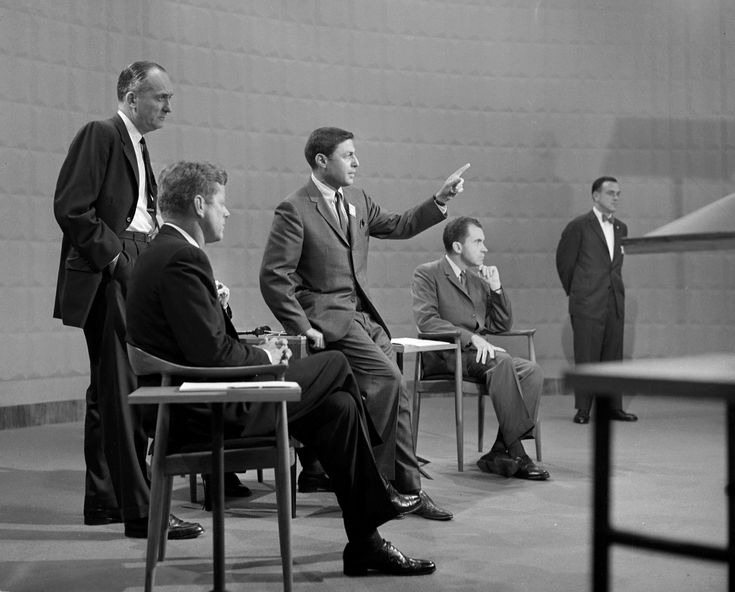 CBS News producer Don Hewitt (center) gestures while making arrangements for Kennedy and Nixon to speak in the first televised presidential debate, 1960.