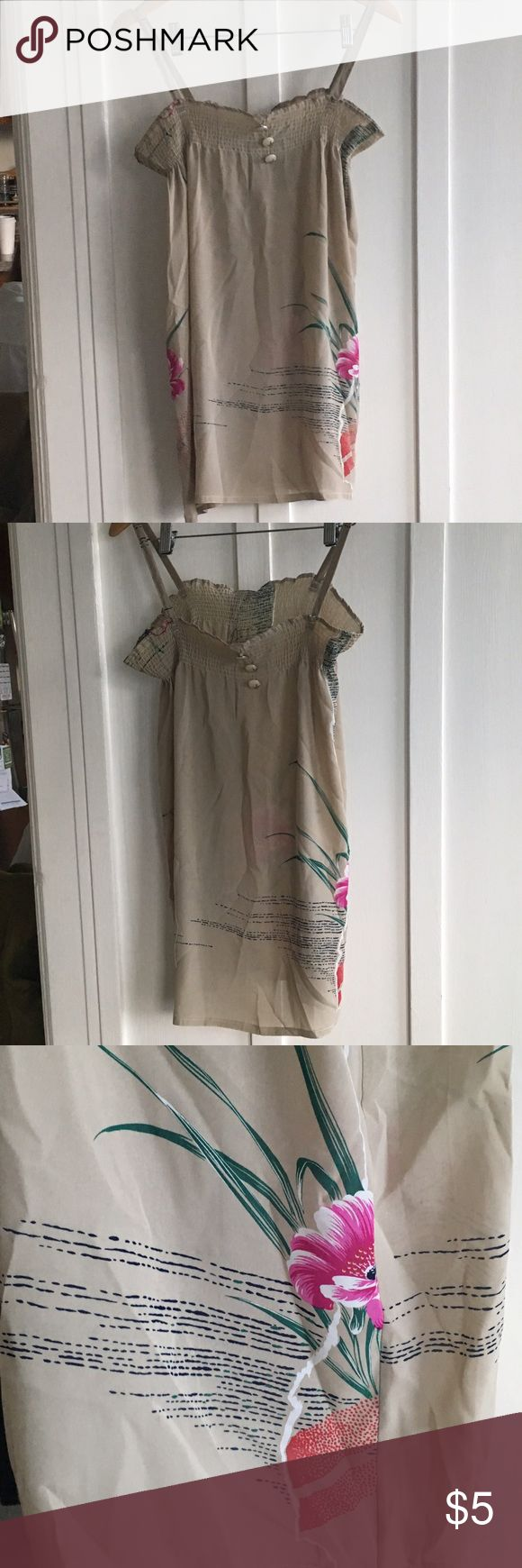 LAST CHANCE flowy floral beige cami LAST CHANCE (will remove listing in 5 days) this flowy beige cami features beautiful floral print and decorative buttons. not sure of material (bought in thailand), probably rayon. not stretchy, in good condition. Tops Camisoles