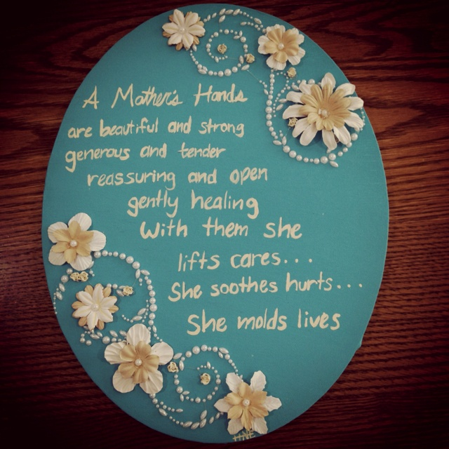 """Pinner says, """"This is what I did for my mothers day present. I used oval canvas and blue paint from hobby lobby and used the scrapbook flowers, pearl stick on design  from hobby lobby and used light yellow paint for the words"""""""