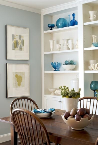 White cabinets, blue walls, wood tones... all looks nice, modern, updated. Dining room shelves