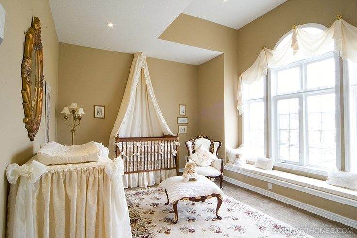 This nursery features high ceilings and a large arched window. Meadowlands in Ancaster, Ontario. By Landmart Homes. #hamont #bedroomideas