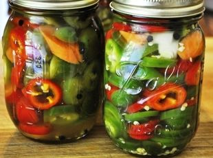 Texas Jalapeno Pickles.    These sweet and hot jalepenos are favorite appetizers when poured over a block of cream cheese and served with crackers. Depending on the crop, some peppers will be much hotter one year and mildly hot another. Use the sugar to ajust the overall heat level of the pickles to your taste.