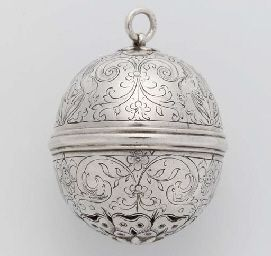 A RARE ENGLISH SILVER MUSK POMANDER, APPARENTLY UNMARKED, CIRCA 1600 Spherical, the moulded mid-rib with bayonet fitting, the lower hemisphere with finely pierced and engraved rose below a band of masks flanked by grotesque scrolls and flowers