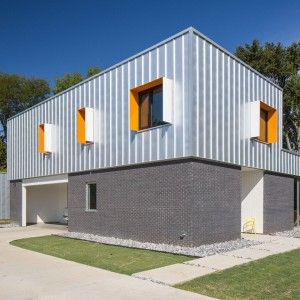 Designshop+uses+metal+and+brick+to+clad+rural+Tennessee+home