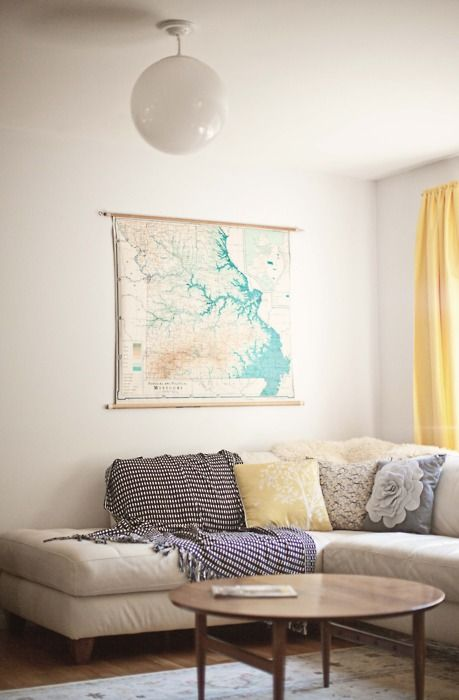 .: Wall Art, Living Rooms, Lights Fixtures, Round Coffee Tables, Colors, Yellow Curtains, Vintage Maps, Old Maps, Pillows