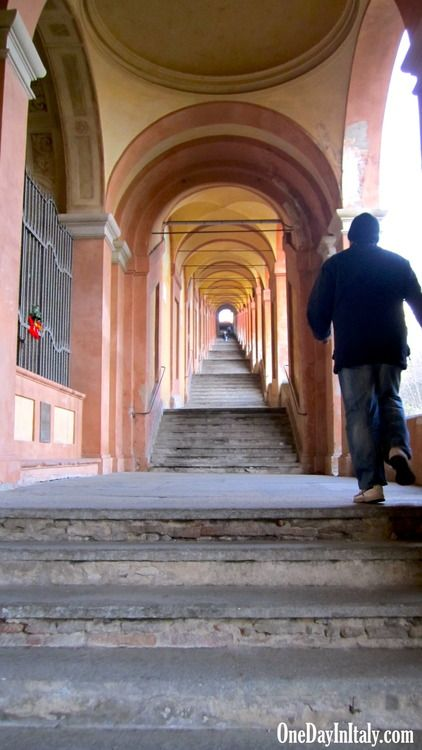 Walking Bologna's Portico di San Luca - VIDEO - The 666 arches leading up to Bologna's Church of St. Luke represent a snake (the devil) being crushed by the church (God) above it on the hill - One Day In Italy - Travel blog of Italian travel, culture and fun