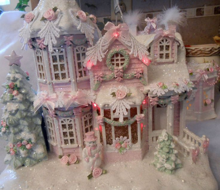 Christmas village house painted in pink, white, light green ~ embellished with ribbon, roses, lace, glitter. Lights change color & move with the music.