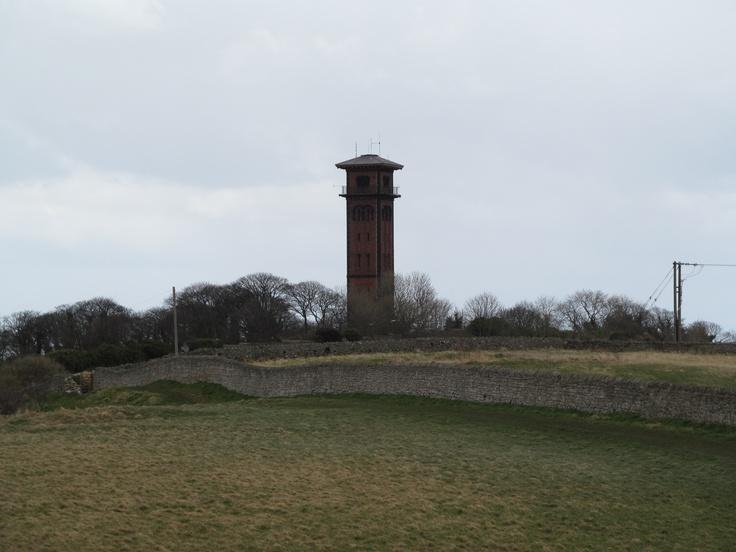 Cleadon Water Tower against a grey sky.