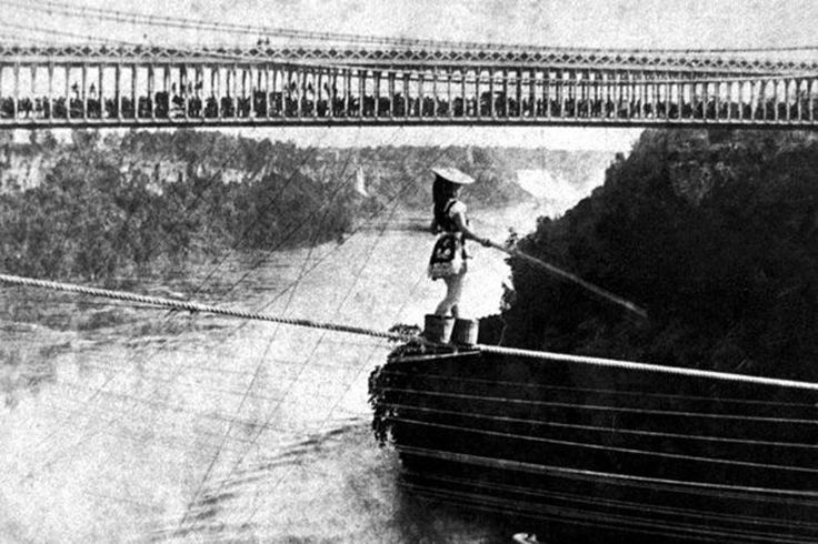 Maria Spelterini crosses the Niagara Gorge from the US side with her feet in peach baskets in 1876