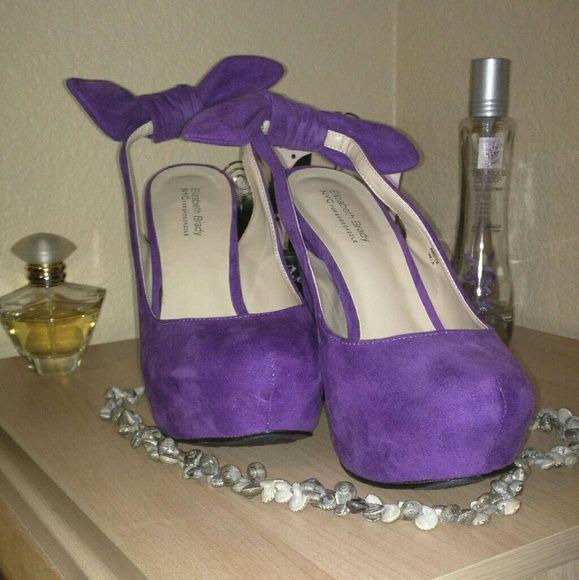 Purple Wedge shoes With A Bow Worn twice. In great condition! Has a hidden platform making them easy to walk in. Elizabeth Brady Shoes Wedges