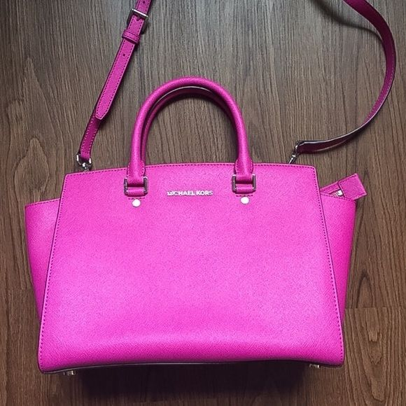 "Authentic  Michael Kors Selma bag Beautiful fuchsia Michael Kors Selma bag. Lightly used and in great condition! Dust bag included. NO TRADES OR PP Details: •silver hardware •top zip close •shoulder strap •inside pockets  About 17"" x 9 1/2"" Michael Kors Bags Satchels"