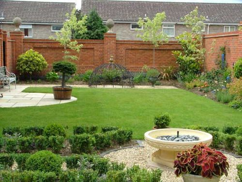 Exotic back garden with brick fence gallery