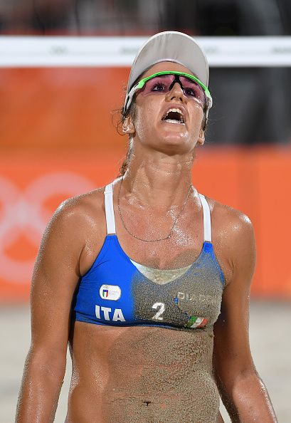 Laura Giombini of Italy reacts during the Women's Beach Volleyball preliminary round Pool D match against Jamie Lynn Broder and Kristina…