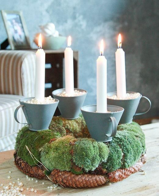 taper candles in cups