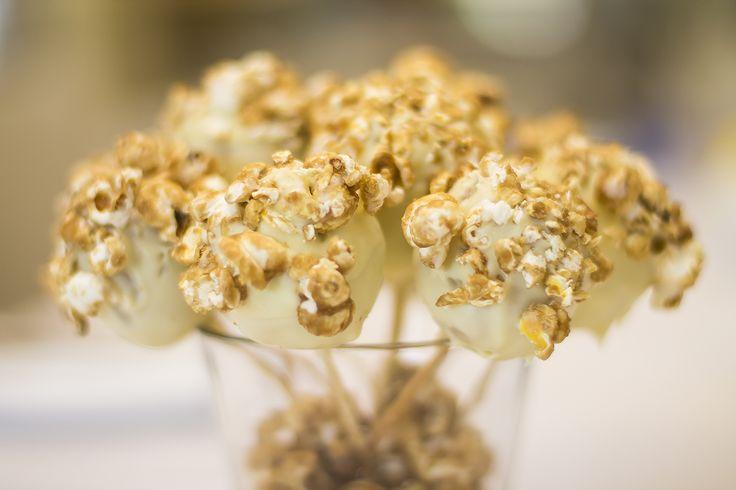 Chef Alicia's popcorn cake balls in white chocolate.