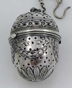 German Sterling Ornate Tea Ball - maybe if I made tea from leaves (instead of tea bags) with one of these my cup would taste more of tea leaves than tea chest...