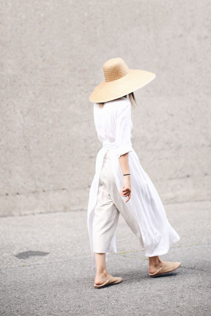 All white jumpsuit and straw hat for summer