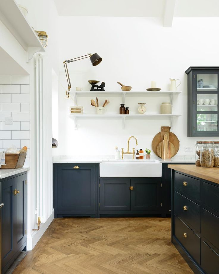 Pantry blue cabinets, bras accents, open shelving, parquet flooring | See this Instagram photo by @devolkitchens