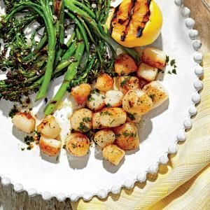 Scallops come one of two ways: wet or dry. Ask at the fish counter for dry scallops, which are in their natural state, have a milder, purer flavor than wet scallops, and sear beautifully.