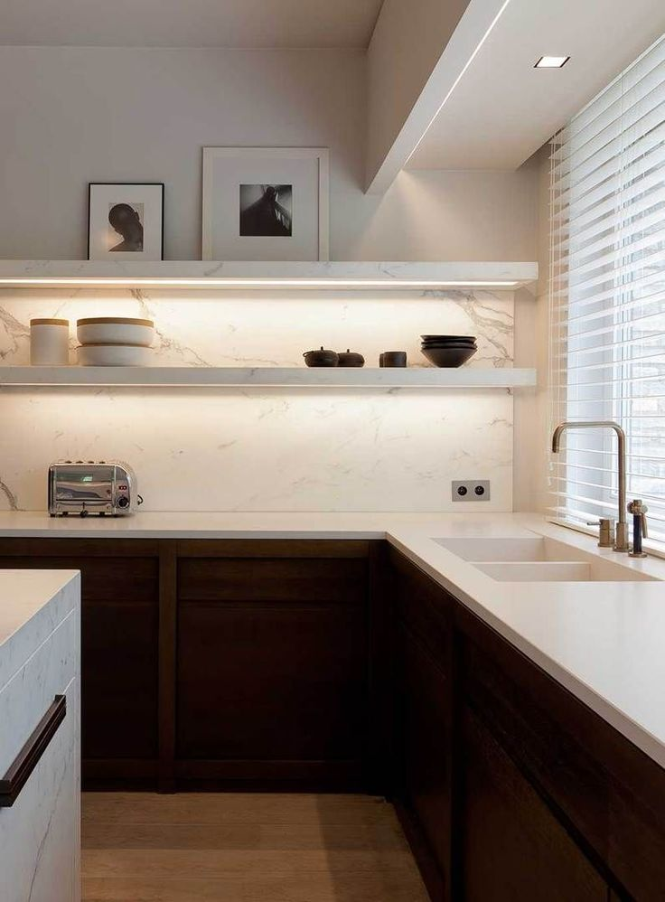 Modern kitchen with marble, sleek lines and open shelving