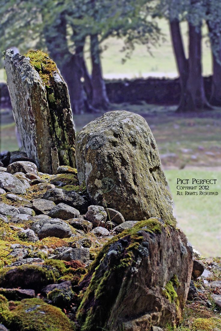 Clava Cairns by Culloden, Scotland. Cairns are stones stacked one on top of another. Clava Cairns is the site of an exceptionally well preserved group of prehistoric burial cairns that were built about 4,000 years ago. The Bronze Age cemetery complex comprises of passage graves, ring cairns, kerb cairn, standing stones in a beautiful setting and the remains of a chapel of unknown date.