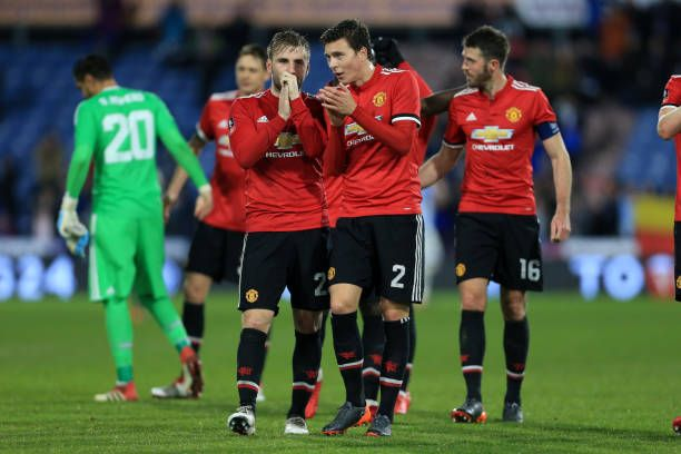 Luke Shaw of Man Utd talks to teammate Victor Lindelof at the end of The Emirates FA Cup Fifth Round match between Huddersfield Town and Manchester...