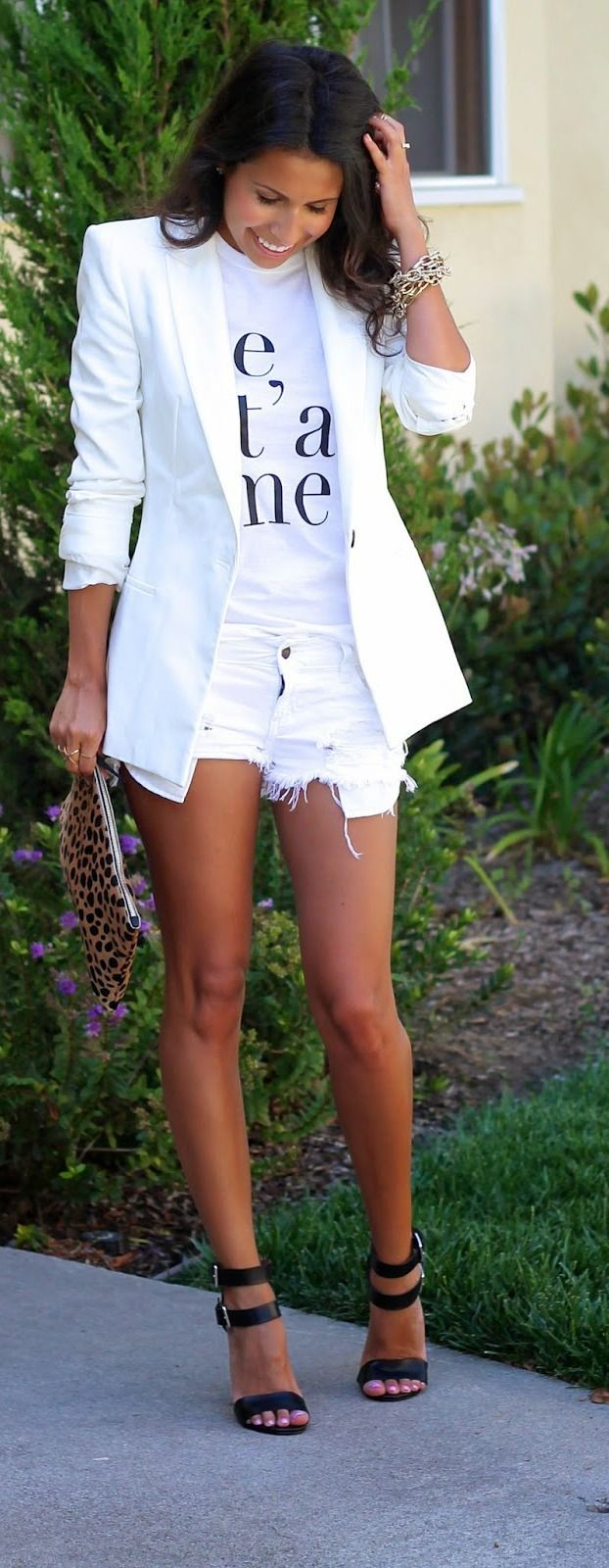 Shop this look on Lookastic: https://lookastic.com/women/looks/blazer-crew-neck-t-shirt-shorts-heeled-sandals-clutch-bracelet/11072 — Gold Bracelet — White and Black Print Crew-neck T-shirt — White Blazer — White Ripped Denim Shorts — Tan Leopard Suede Clutch — Black Leather Heeled Sandals