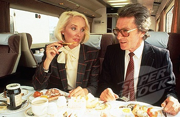 Costume - Business people having breakfast on a train, c 1980s