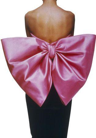 """Yves Saint Laurent, Black velvet sheath dress, """"Paris rose"""" satin bow, """"Paris"""" haute couture collection, Fall-Winter 1983"""