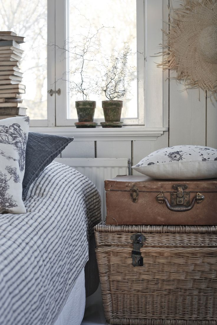 The use of classic ticking stripes, toile and floral fabrics is a look that can can cross over many decorating styles. French country, classic or even coastal. Using the lovely wicker trunk and vintage leather case gives a lovely homely feel.