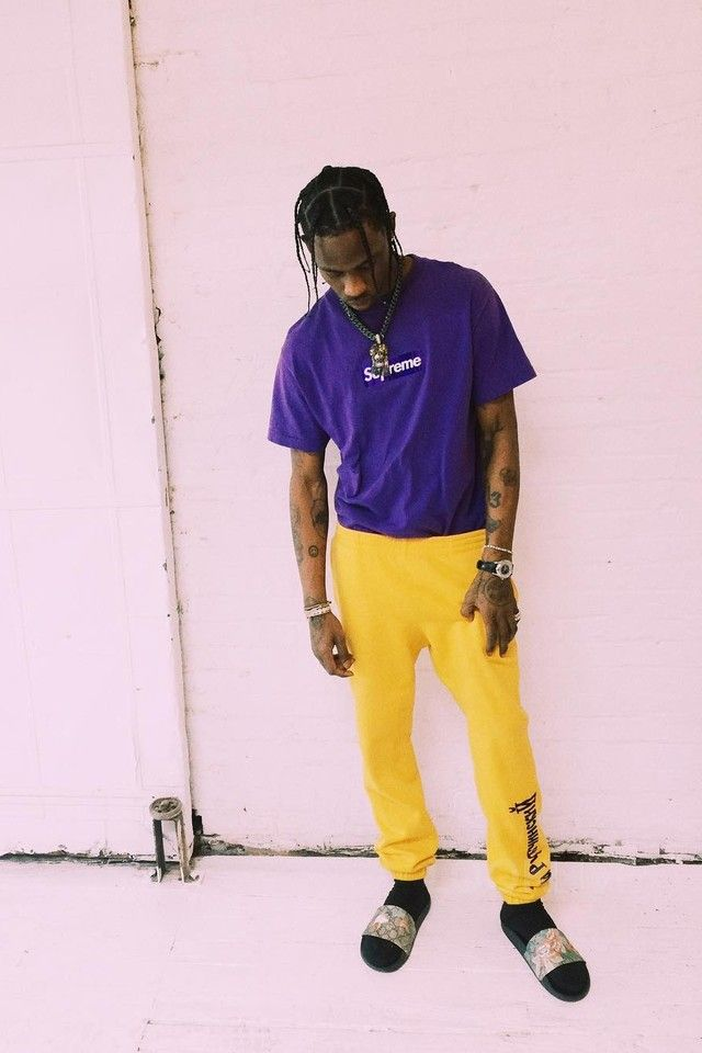 Travis Scott wearing Gosha Rubchinskiy Logo Sweatpants, Gucci Tian Slide…