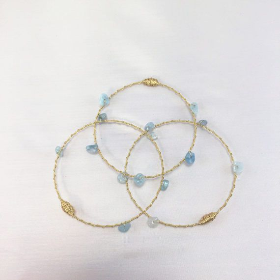This months birthstone is AQUAMARINE! ***Monthly Birthstone Bangle SALE! Normally $45. Offer is good through the month of March! Check out these dainty bangle bracelets made with Recycled Guitar String and ethically-sourced gemstones. These bracelets are standard size with a 2.75 diameter, and fit most hands. Each piece is lovingly handcrafted in our New Orleans Studio!  Handcrafted with love, each piece of ReStrung™ Jewelry incorporates Recycled Instrument String donated by musicians from…