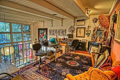 view from the second story loft of our studio. Murals, drawings and items created or collected by Ralf W. Johnstone, Jeanette Johnstone, Linda Johnstone Allen, and others on display. Also, on this level, a computer station for design work and general storage.