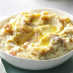 Rich & Creamy Parmesan Mashed Potatoes Recipe -For special occasions (like my husband's birthday dinners), I mash my potatoes with cream cheese, sour cream and Parmesan. It's divine comfort food. —Jo Ann Burrington, Osceola, IN