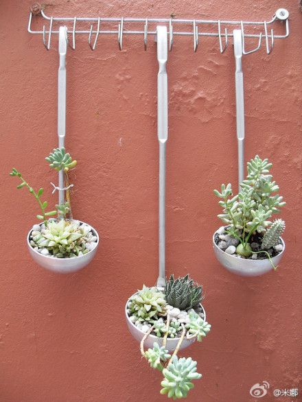 Ladle planters : easy and nice looking Love this....I am picturing them on the wall of my cabin porch!