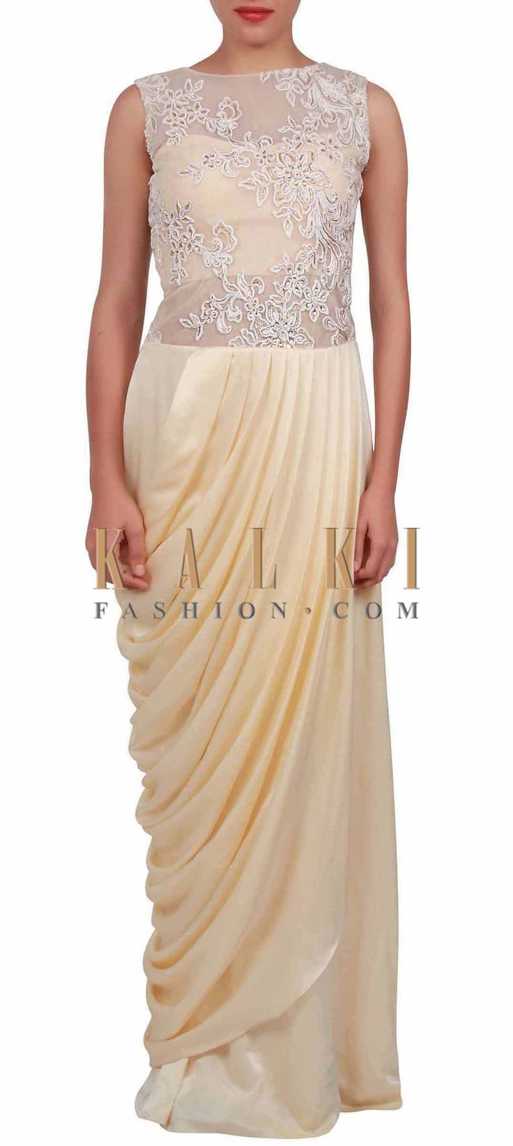 Buy Online from the link below. We ship worldwide (Free Shipping over US$100) http://www.kalkifashion.com/cream-saree-gown-embellished-in-cord-and-zardosi-embroidery-only-on-kalki.html