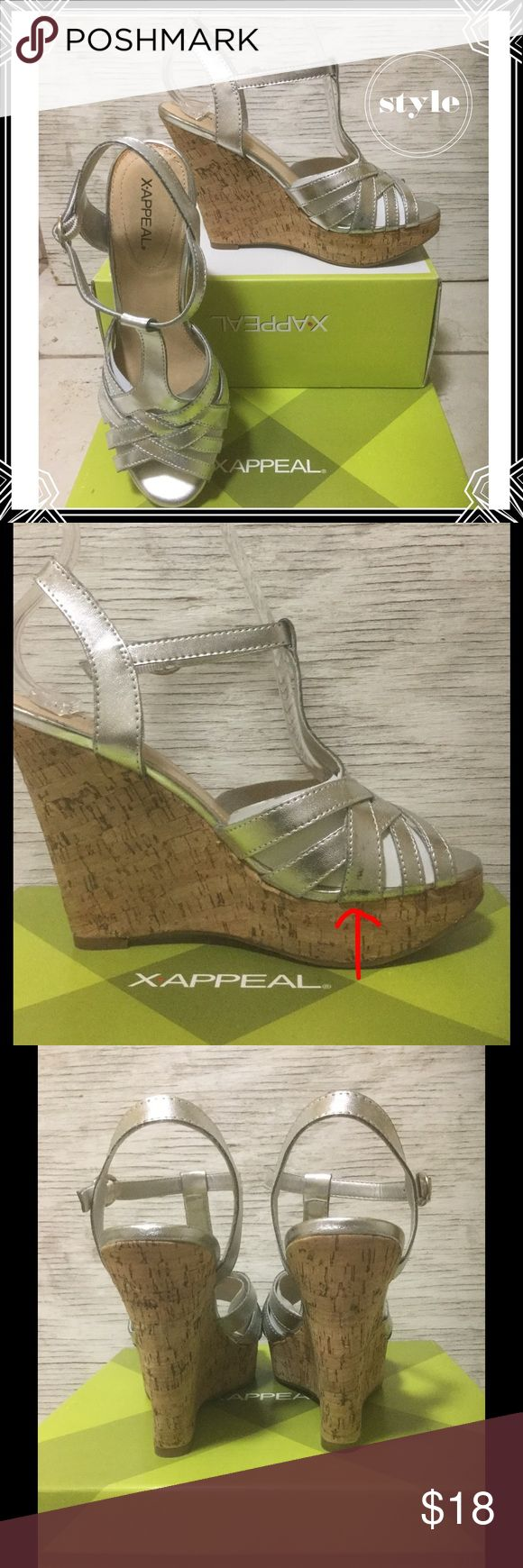 """X-APPEAL Silver Wedges Bring in the New Year with these gorgeous silver wedges. Shoes are in excellent used condition, the only flaw is a small scuff as shown in picture 2. Heel is 4.25"""" platform 1.25"""". X-Appeal Shoes Wedges"""