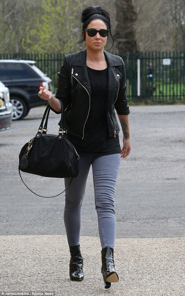 Back to the day job: Tulisa Contostavlos wore a stern expression as she was pictured arriv...