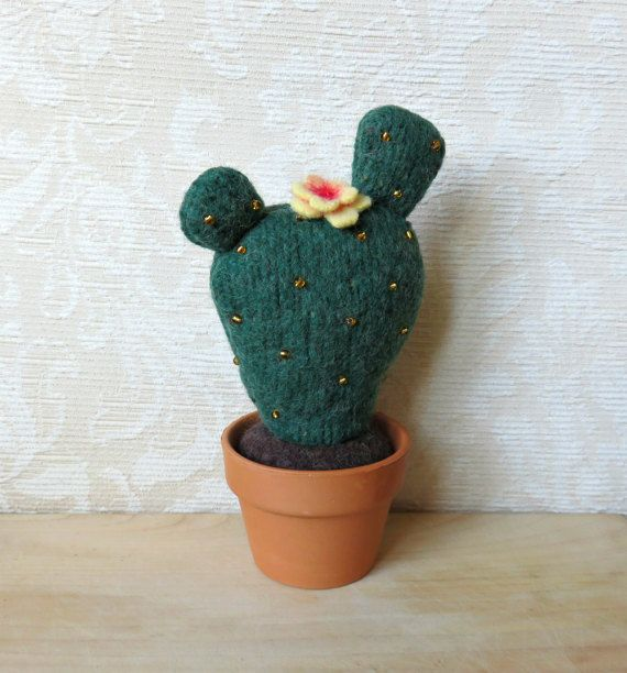 My Succulent Softies were featured in the Spring 2014 issue of STUFFED magazine!  Heres the perfect plant for those without a green thumb. This plush prickly pear cactus will never need water! Great as a home décor item, on your office desk, or keep it by your sewing machine and use it as a pincushion. Collect all three styles for a grouping of cactus!  Made from felted, or fulled, repurposed wool sweaters, this blooming cactus is 8 1/2 inches tall and about 4 1/2 inches wide and co...