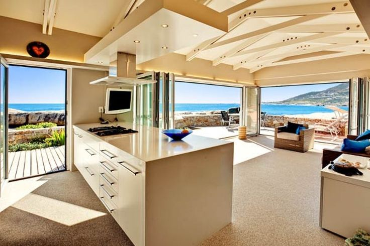 Open plan kitchen and living area. Every room displays stunning views