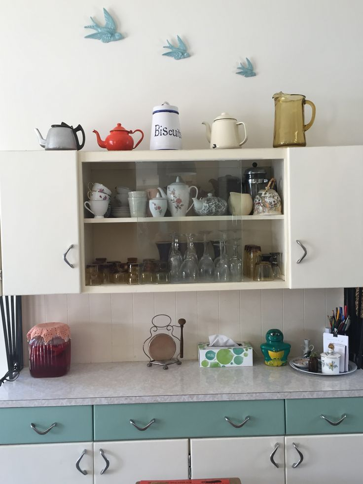 1950s kitchen dresser, kombucha brewing in the corner, op shop find flying swallows on the wall above.