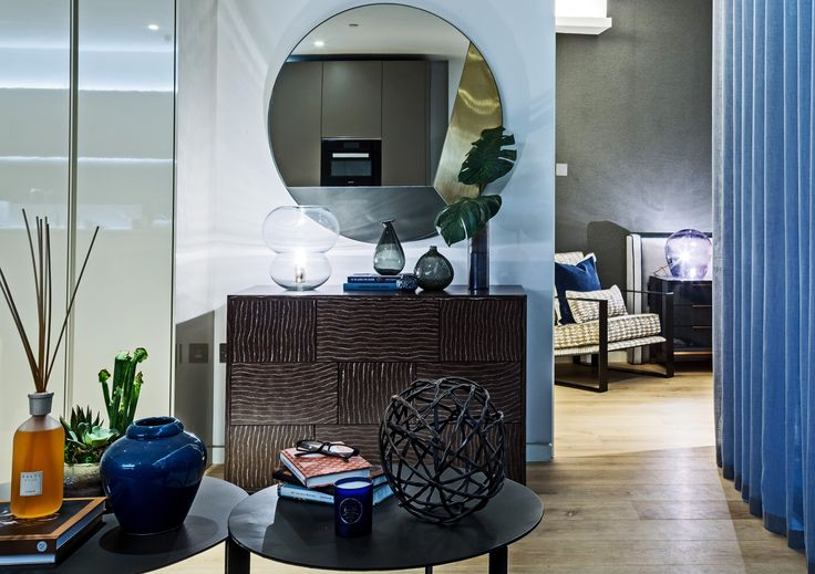 Warm and inviting, this rich bark effect sideboard by Michael Northcroft adds an organic, earthy element to the living area of our Soho apartment design, the abstract mirror above reinforcing the trendy, contemporary theme throughout.