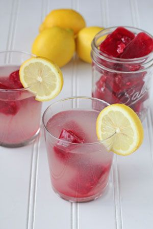 Lemonade with strawberry ice cubes.