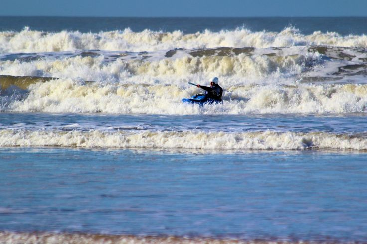 Kayaker at Woolacombe Beach. Enjoying All There Is To Offer When Staying With Ocean Cottages in North Devon